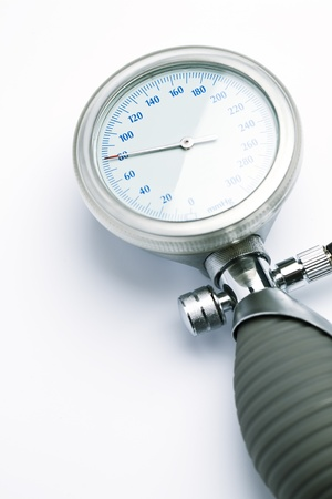 A blood pressure meter or sphygmomanometer over a white background  photo