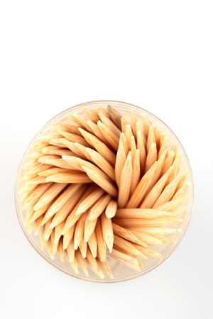 A top view of a package with many wooden toothpicks on plain white background. Stock Photo - 20259712