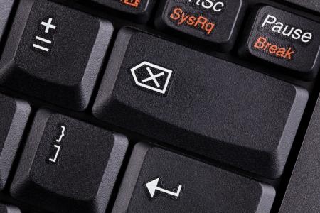 A closeup image of a laptop keyboard with sleek black keys and soft side lighting. photo