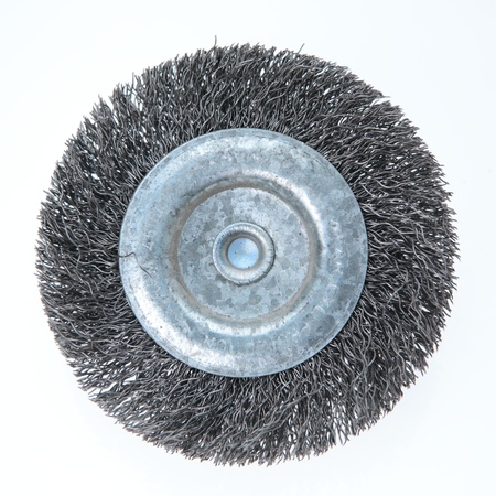 abrasive: An abrasive drill brush photographed over plain background. Stock Photo