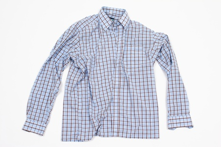 informal clothes: A male shirt with long sleeves on plain background.