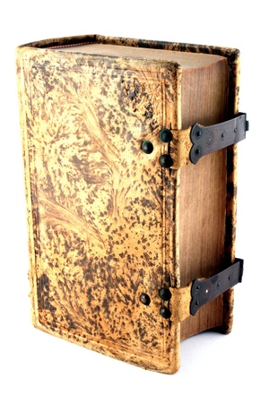 the scriptures: A thick old book isolated on white with locking mechanism applied. Stock Photo