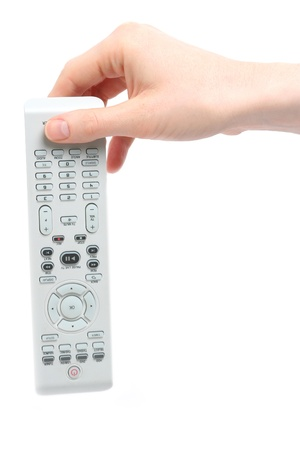turn away: A Caucasian female hand dropping down a remote control