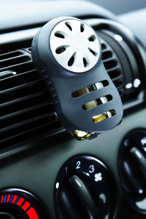 A car ventilation system with an air car perfume on it