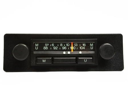 A very old car radio receiver isolated on white background - front panel view. photo