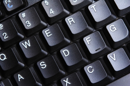 A closeup image of a laptop keyboard with sleek black keys and soft side lighting. Stock Photo - 20389147