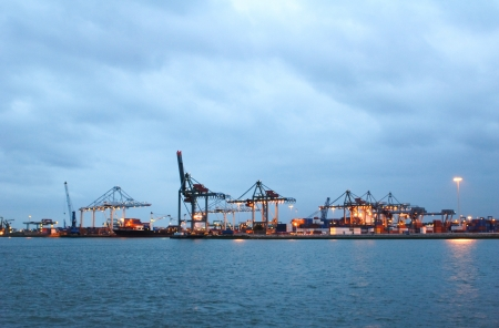 The docks at the Rotterdam harbor on a cloudy evening. photo