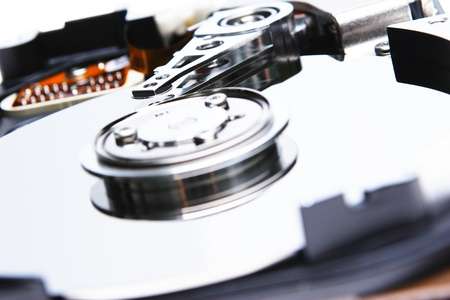 An open hard disk device with reading heads. Stock Photo - 20389084