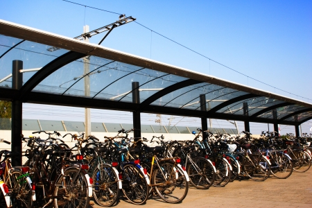 parked bicycles: Parked bicycles at a European train station. Stock Photo