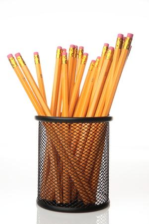Ceruzák a fekete ceruzatartó, fényképezett több mint sima háttér másolatot helyet.