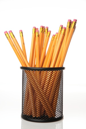 Pencils in a black pencil holder, photographed over plain background with copy space. Stock Photo