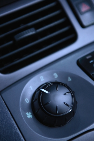 regulating: A modern car ventilation knob for regulating the speed of the incoming airflow.