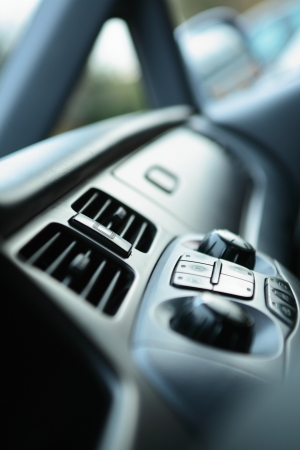 Modern car ventilation knobs for regulating the speed of the incoming airflow and its direction. Stock Photo