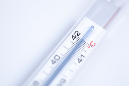body temperature: A clinical thermometer showing high and unhealthy body temperature of 42 degrees Celsius.