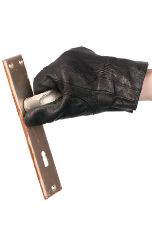trespasser: A thiefs hand holding a detached door handle over white background.