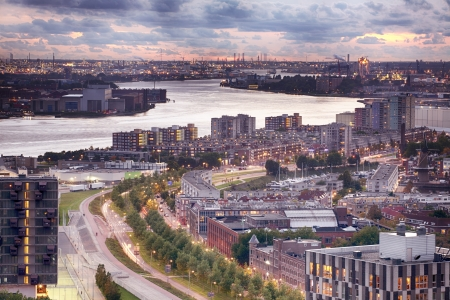 A view of the inner part of the Rotterdam harbor port along the banks of the Maas  Meuse  river transitioning into the residential area of the city  bottom part of the image