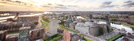 euromast: A view of the city of Rotterdam from the Euromast tower, showing the western area of the city - the port of Rotterdam, residential area, as well as the Maas river. Stock Photo
