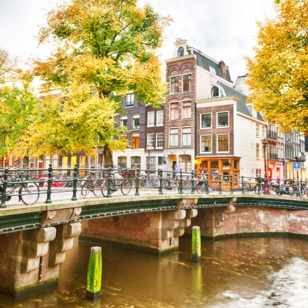 Typical houses and a canal in Amsterdam, the Netherlands  Photographed in the autumn