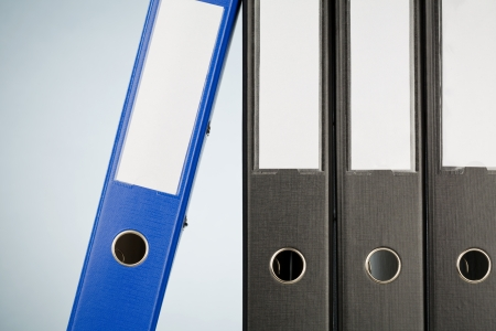 Closeup image of a row of office folders or binders. Stock Photo