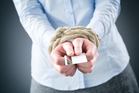 負債概念または隠喩 - と実業家縛られ手のクレジット カードを保持します。 写真素材