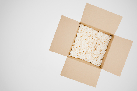 padded: Top view of an open packaging box over a plain background. Stock Photo
