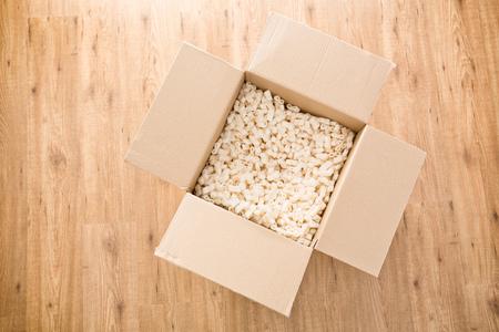 foam box: Top view of an open carton box with foam filling or padding inside.