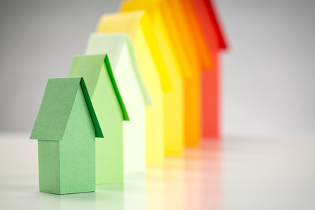 Paper houses in energy label colors, focus on the most efficient green house. photo