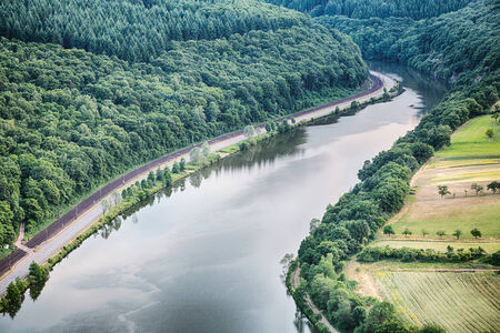 saar: The river Saar in Germany passes along a forest and farming fields.