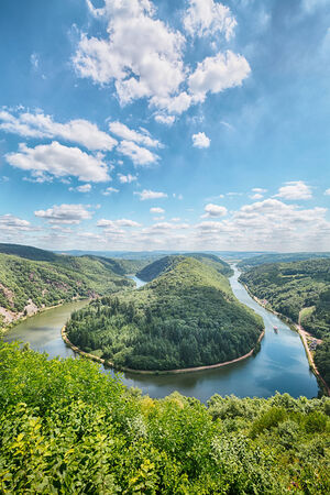 saar: The river Saar bend near Mettlach in Germany, also known as Saarschleife. Vantage point view from Cloef with blue sky and a few clouds.