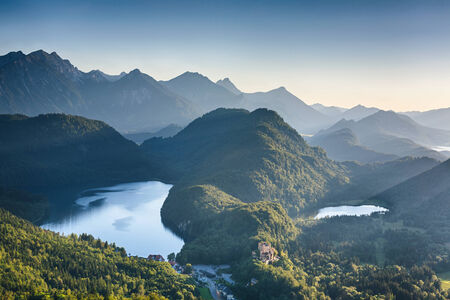 schwangau: Alpine lakes at sunset - the Alpsee bei Schwangau and the smaller Schwansee among hills and peaks. Photographed from the hills above the Neuschwanstein castle.