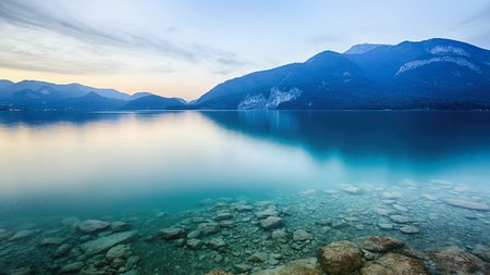 sunset lake: Lake Wolfgangsee in the Austrian Alps by sunset in the summer. Stock Photo
