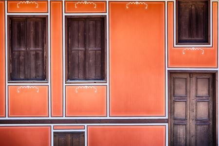 dormer: Dark orange decorated facade with closed dormer or garret windows in Koprivshtitsa, Buglaria.