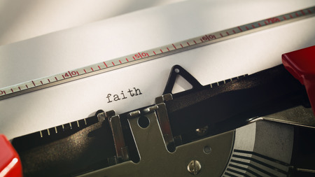 oldschool: Closeup of the word faith typed on an old-school typewriter. Stock Photo