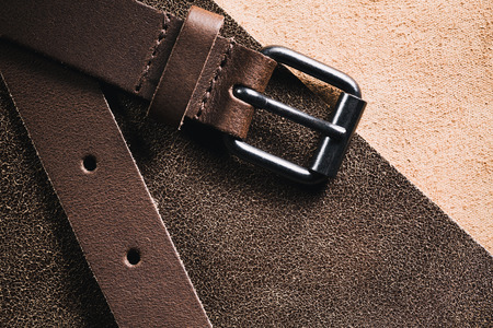 Leather belt over a real leather fabric.