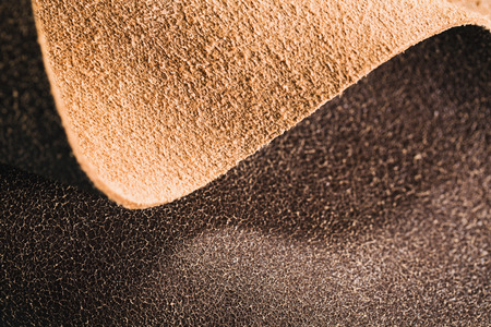 Natural brown leather folded in a wave. Top view. Stockfoto
