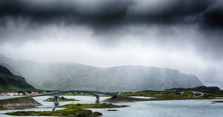 Heavy clouds over a motorway with curved bridges on the Lofoten Islands, Norway.