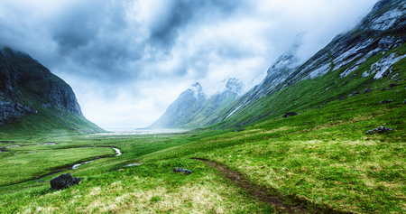Scenic view of a valley leading to Horseid beach on the Lofoten Islands, Norway. Stockfoto