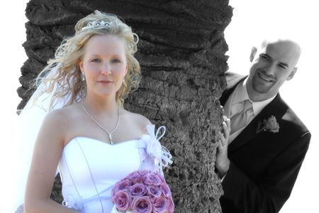 bride poses for photo while groom looks on
