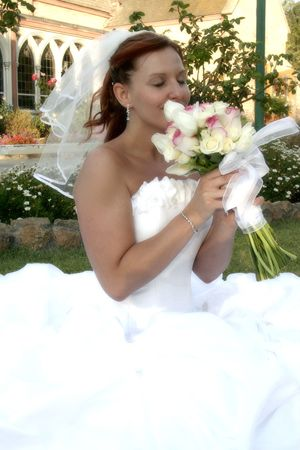 smells: bride smells her bouquet