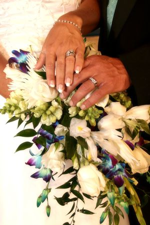 show off: bride and groom show off their rings Stock Photo