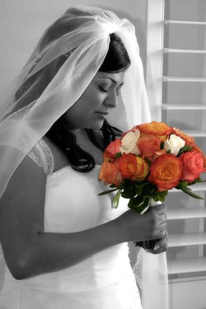 bride smells her bouquet