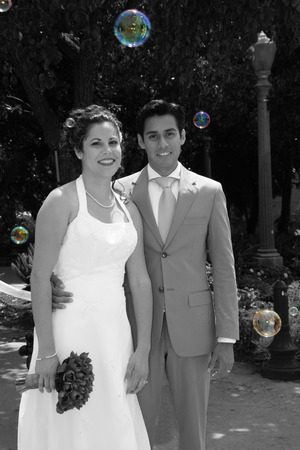 bride and groom standing in bubbles