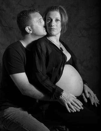 dad and mom show off her pregnant belly