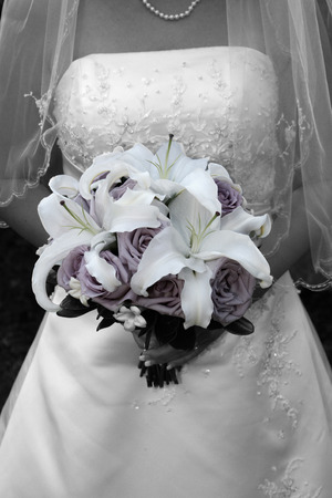 the front side of a bride holding her bouquet