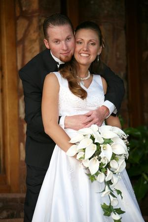 groom gives his bride a hug Standard-Bild