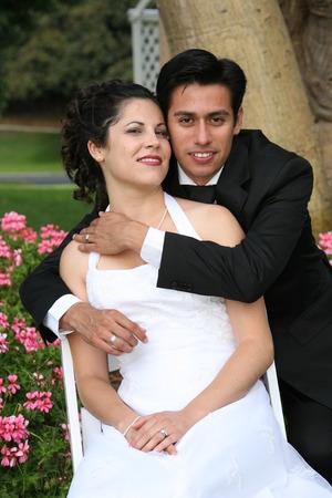 groom puts his arms around his bride Standard-Bild