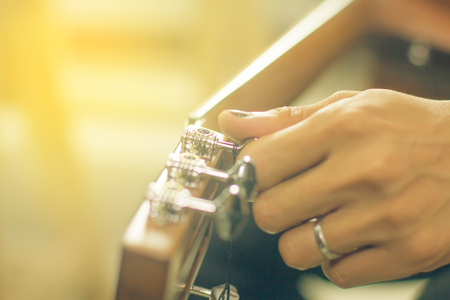 Vintage guitar player in artistic performance Stock Photo