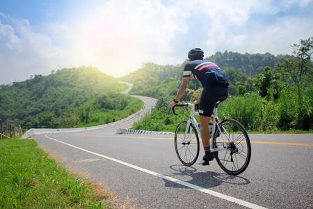 Men cycling mountain road bike in the morning Stock Photo