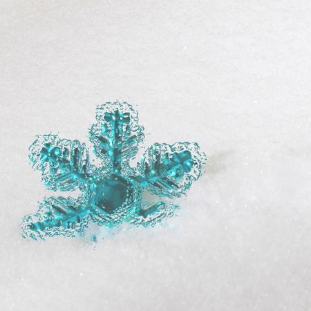 Plastic snowflake in the snow