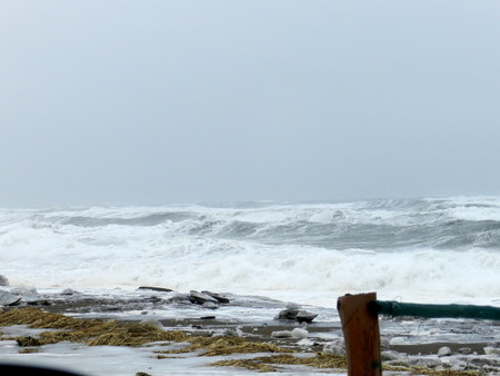 Winter landscape by seashore During a storm